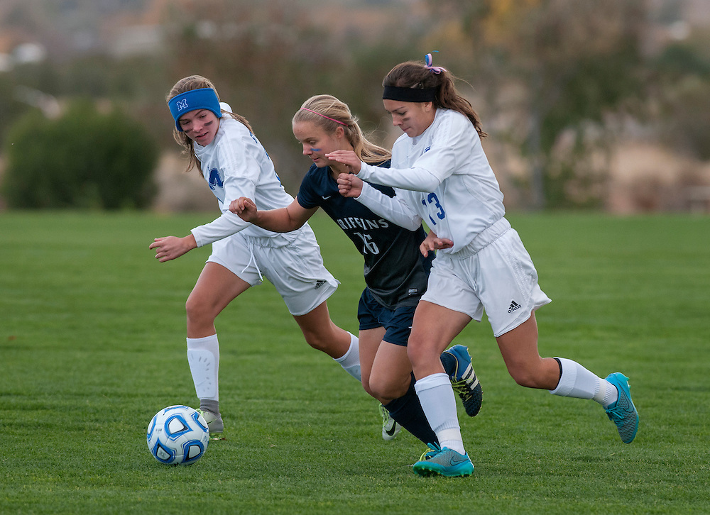 em110316n/jnorth/sports/St. Michael's Frances Schneider, left, and Maya Chavez, right, battle Santa Fe Prep's Lynn Robey during their state tournament playoff game. The game was played in Bernalillo Thursday November 3, 2016.  St. Michael's won 3-2. (Eddie Moore/Albuquerque Journal