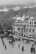 Downtown Lhasa Tibet, with Potala Palace in the background. The town center is an interesting mix of old and new, chinese and tibetans, bikes and yaks.