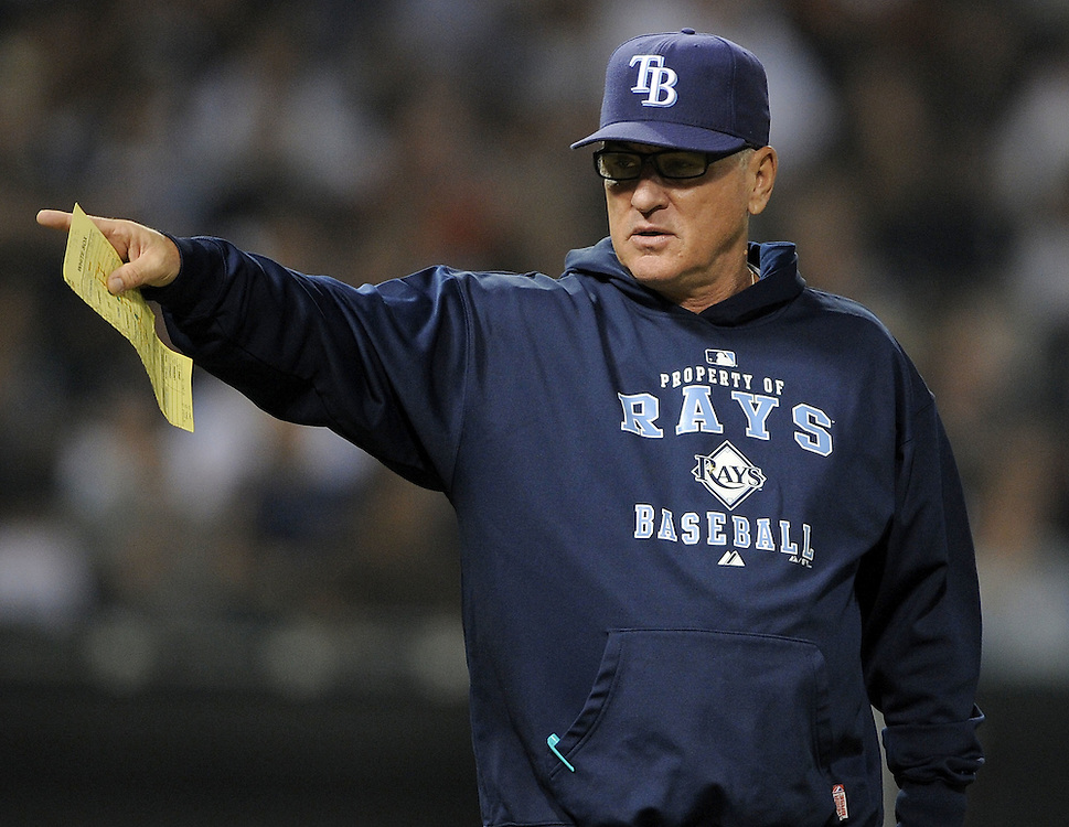 CHICAGO - JULY 22:  Manager Joe Maddon #70 of the Tampa Bay Rays makes a pitching change against the Chicago White Sox on July 22, 2009 at U.S. Cellular Field in Chicago, Illinois.  The White Sox defeated the Rays 4-3.  (Photo by Ron Vesely)