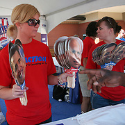 Volunteers for ID ACTION,  the nonpartisan Iowans with Disabilities in Action project,  designed to increase the active participation of Iowans with disabilities in political and civic opportunities that promote positive change, pass out John McCain and Barrack Obama cutout heads at the Iowa State Fair in August of 2008..
