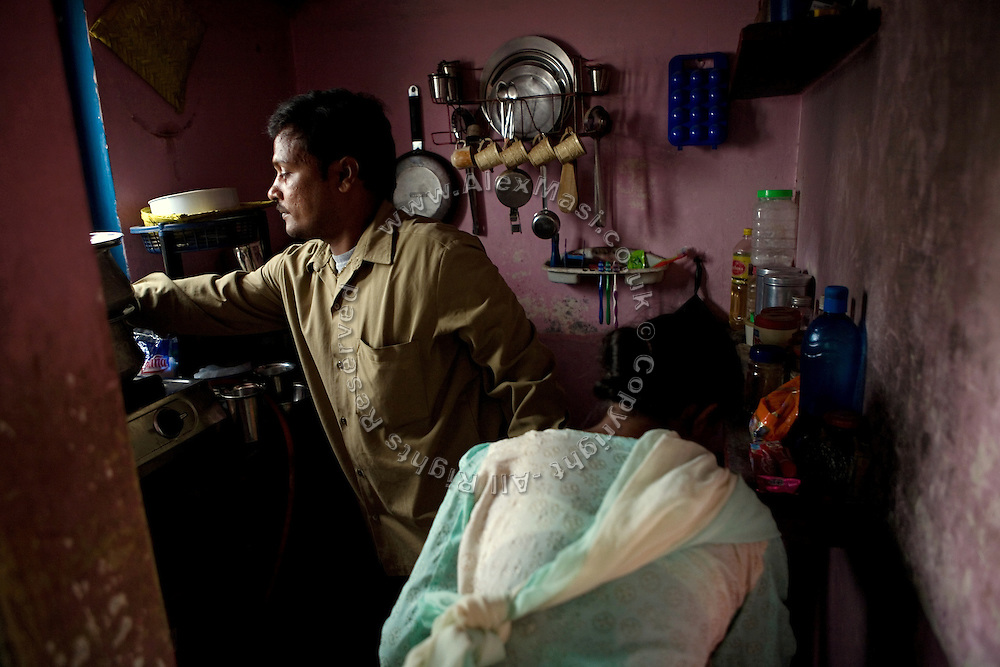 Shafiq Syed, 34, is helping his wife preparing tea in their home kitchen inside a poor neighbourhood of Bangalore, Karnataka, India. Shaifq has been the main character of the Cannes' Camera D'Or 1988 winner Salaam Bombay, but after the movie he failed to become a star, fell back into poverty and lived on the streets for years before he became a rickshaw (tuk-tuk) driver in his home city of Bangalore, Karnataka State, India.