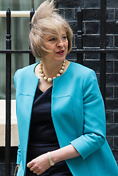 Downing Street, London, June 9th 2015. A windswept Home Secretary Theresa May leaves 10 Downing Street following the weekly meeting of the Cabinet.
