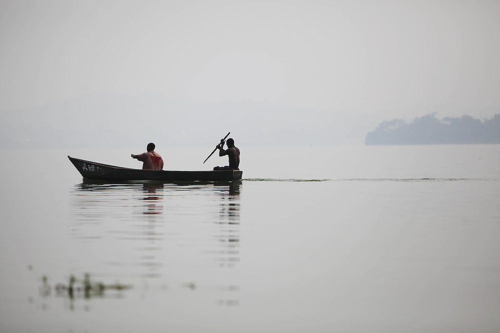 Two fishermen head to retrieve their nets after a morning of fishing on Lake Victoria. Here in Ggaba, a small town in southern Uganda that almost entirely subsists on the fishing industry, the locals have contributed to the dangerous overfishing of the lake despite strict regulations from Tanzania, Uganda, and Kenya. Fishermen continue to keep fish that are far below the required minimum weight and employ dymanite and poison.