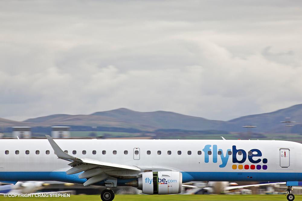 A Flybe plane landing at Edinburgh aiport, Scotland, UK