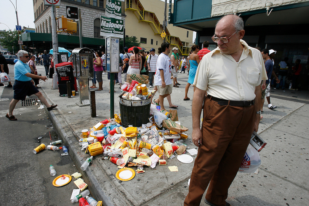 NEW YORK, NY-06 JUL04-- Overflowing trash cans surround Nathan's Famous Delicatessen on Coney Island, shortly after the event. (Extra) The Gazette/Liam Maloney