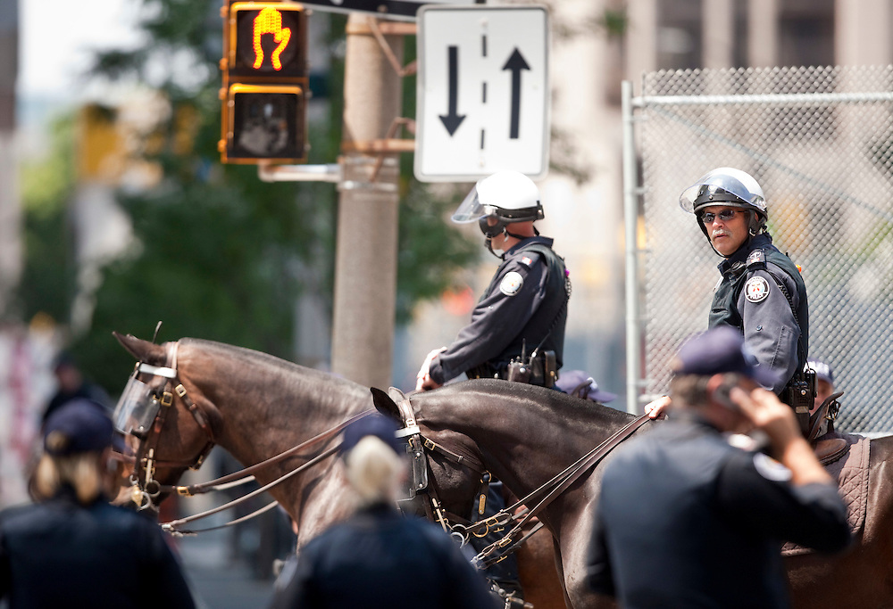 Police on horseback patrol the nearly deserted streets of downtown Toronto, Canada, June 25, 2010 where most office workers were told to work from home Friday as the city prepares to host the G20 leaders this weekend.<br /> AFP/GEOFF ROBINS/STR