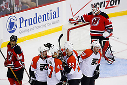 Oct 24, 2008; Newark, NJ, USA; The Philadelphia Flyers celebrate a goal by Philadelphia Flyers left wing Scott Hartnell (19) during the second period at the Prudential Center.