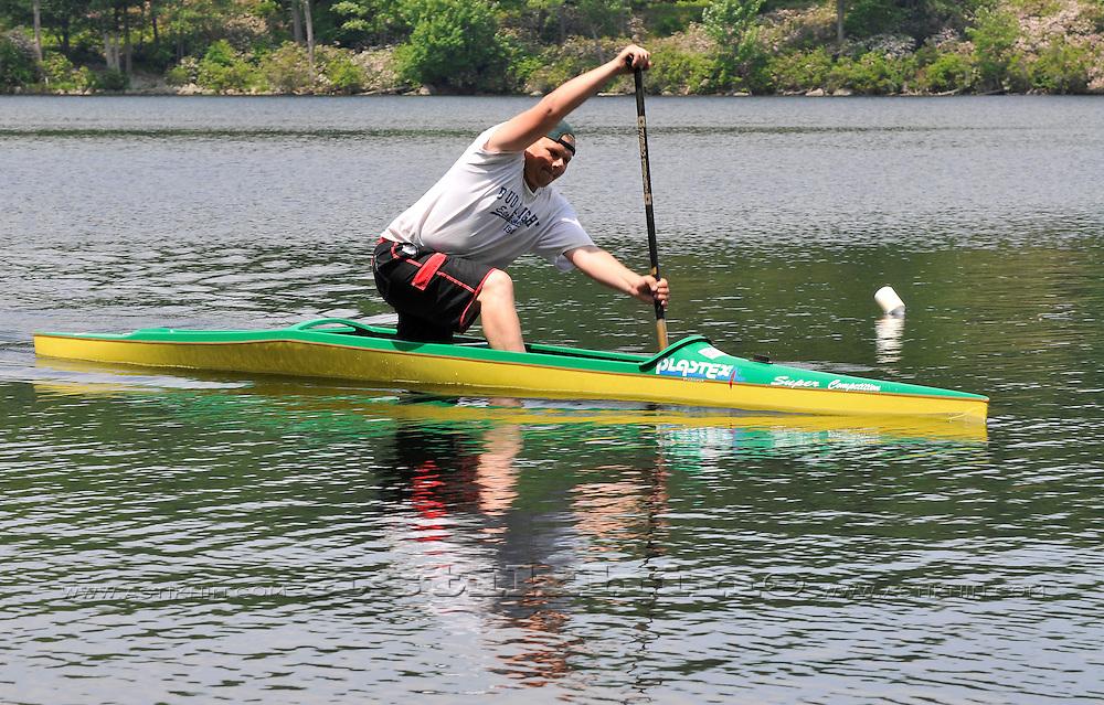 Paddling Olympic style C1 canoe.