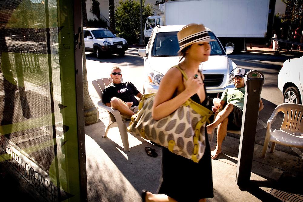 Huntington Beach, California, Surf City, USA..Huntington Beach is a legendary surf beach in California. The surf shop Rockin' Fig Headquarters, run by legendary surfer Rockin Fig, attracts local characters and young surfing talents... ..Ken Lukas (L)..Unidentified girl (C)..Rick Ôø?FigÔø? Fignetti (R)....Photographer: Chris Maluszynski /MOMENT