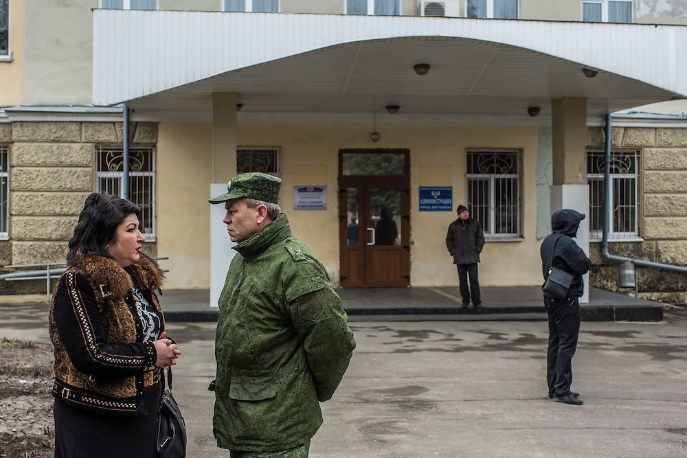 The head of the local administration talks with Eduard Basurin, the Deputy Defense Minister of the Donetsk People's Republic, on Saturday, March 26, 2016 in Dokuchaevsk, Ukraine.