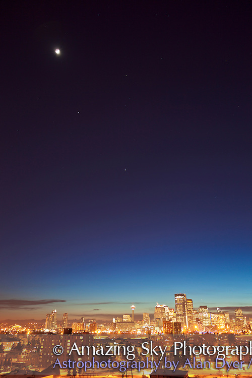 Mercury (low just above buildings at right), Venus, Jupiter and the Moon over Calgary skyline, Feb 27, 2012. Taken with Canon 5D MkII and 28-135mm zoom lens.