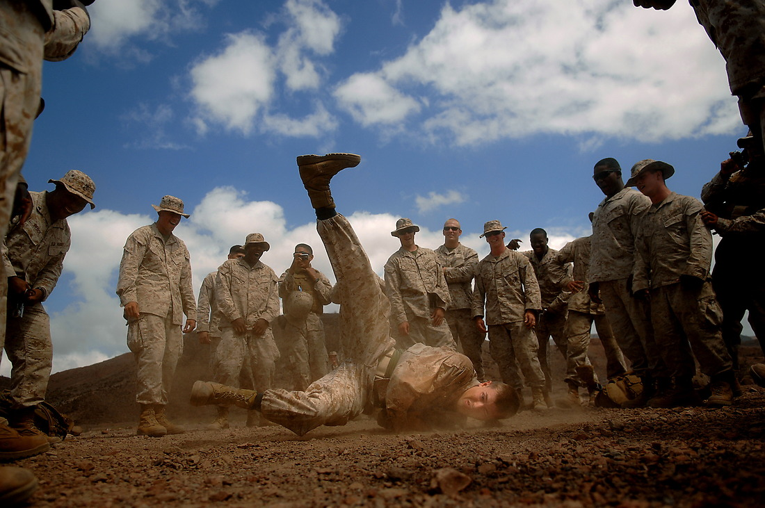 Lance Cpl. Brett Herman from the 3rd Low Altitude Air Defense Battalion, Camp Pendleton, California, break dances during some down time before moving to the next firing range in the Arta region of Djibouti, Africa, on January 23, 2008. The Marines fired the M203 Grenade Launcher AT-4 and threw M67 Fragment Grenades for practice, while deployed with the Combined Joint Task Force - Horn of Africa, located at Camp Lemonier, Djibouti, Africa. — © TSgt. Jeremy T. Lock/