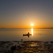 Kayaker at sunset on Dungeness lagoon, inside the Dungeness Spit.