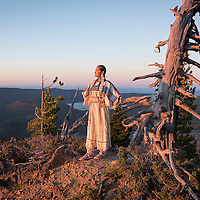 Native woman Acosia M. Red Elk in historic buckskin dress on top of Paulina Peak, Central Oregon, USA