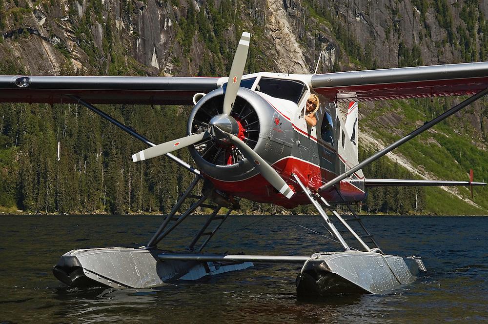 Michelle Masden and Lady Esther, her DeHavilland Beaver DHC-2 floatplane, on Nooya Lake, Misty Fiords National Monument, Alaska.