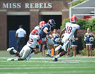 Ole Miss' Zack Stoudt (8) is tackled by Georgia linebacker Amarlo Herrera (52) at Vaught-Hemingway Stadium in Oxford, Miss. on Saturday, September 24, 2011. Georgia won 27-13.