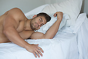 hot man resting in bed