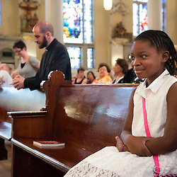 2 AUG. 2015 -- ST. LOUIS -- Jordyn Brownlee, 9, joins other worshipers gathering for Mass Mob III at Sts. Teresa and Bridget Catholic Parish in St. Louis Sunday, Aug. 2, 2015. The event brings Catholics from across the Archdiocese of St. Louis to worship at historic, urban parishes.<br /> <br /> Photo by Sid Hastings.