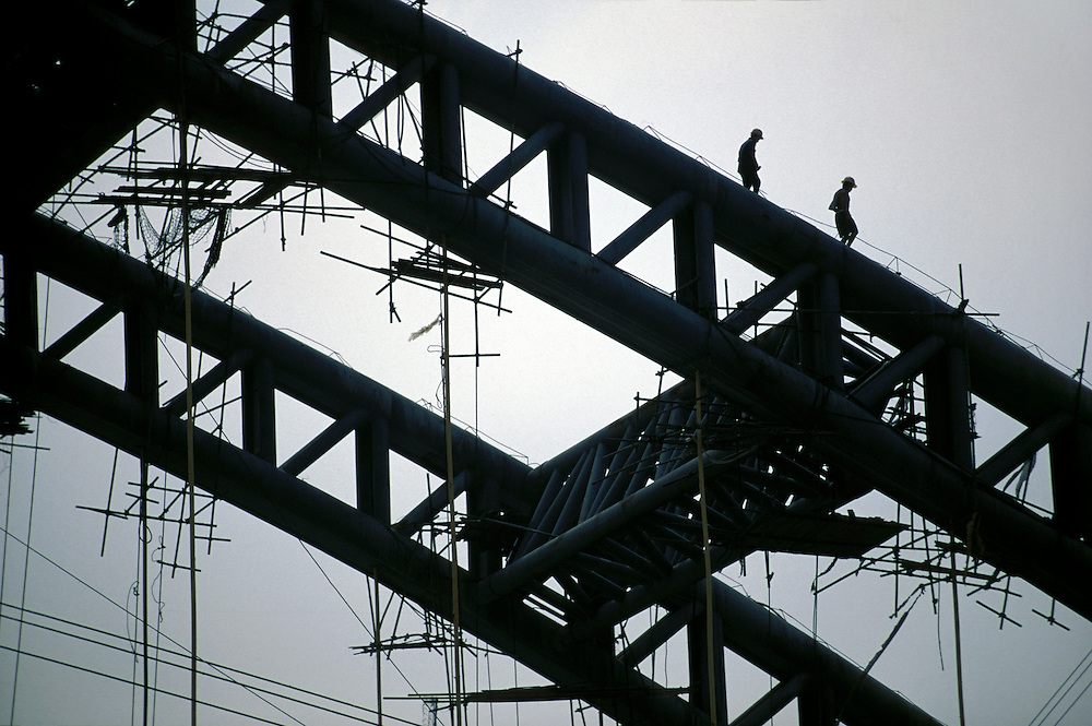 Infrastructure: labourers on bridge construction...From China [sur]real © Mark Henley..