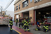 Fire fighters and military veterans Andres Godoy and FF Kamil Mizinsky work together at the 16th Street Fire House of the North Hudson Regional Fire and Rescue in Union City, NJ on November 07, 2013. Many vets say after the military they're still looking for a career with a sense of public service. Some vets have found that at the North Hudson Regional Fire and Rescue in New Jersey.