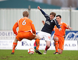 Forfar Athletic's Odmar Faero, Falkirk's David Weatherston and Forfar Athletic's Mark McCulloch..Falkirk 4 v 1 Forfar Athletic, Scottish Cup fifth round tie, 2/2/2013. .©Michael Schofield.