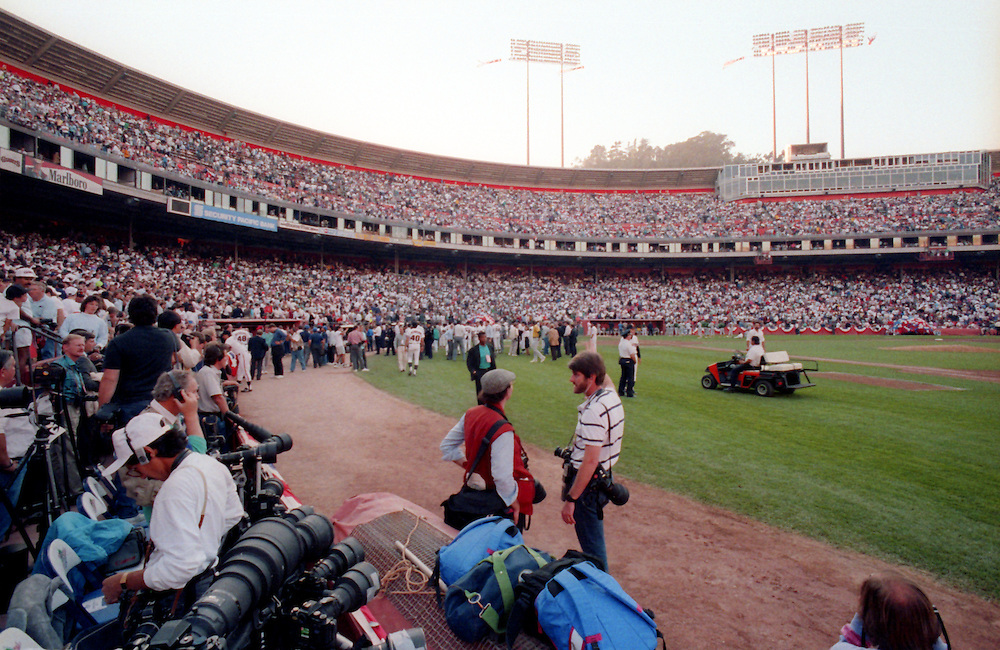 SAN FRANCISCO, CA-OCTOBER 1989: Players and members of the media gather on the field after a 6.9 magnitude earthquake cancelled Game 3 of the 1989 World Series between the San Francisco Giants and Oakland Athletics at Candlestick Park in San Francisco, California.  (Photo by Ron Vesely)