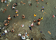 Families and children play at Puerto Hondo, a beach a waterpark built amongst a forest of mangrove trees in Guayaquil, Ecuador.