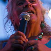 Genny Pits addresses the audience during The 19th Annual Bob Marley People's Festival Saturday, July 27, 2013, at Tubman-Garrett Riverfront Park in Wilmington Delaware.
