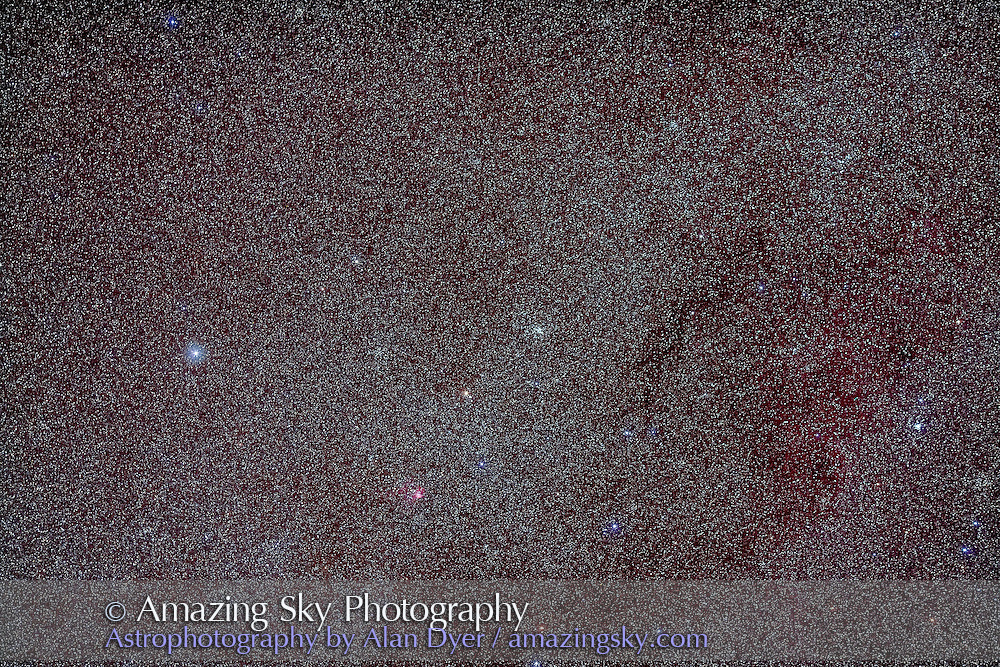 M93 open cluster in Puppis with a 135mm telephoto to simulate the field of binoculars. SMall red nebula is LBN 1065 associated with open cluster NGC 2467. This is a stack of 2 x 3 minute exposures with the Canon 135mm lens at f/2.8 and filter-modified Canon 5D MkII at ISO 800. Shot from Coonabarabran, Australia.