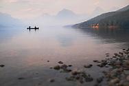 Canoe the tranquil water of Lake McDonald, Glacier National Park, Montana.
