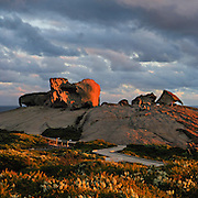 The Remarkable Rocks form fantastic shapes in Flinders Chase National Park, Kangaroo Island, South Australia. The Remarkable Rocks began as magma injected into a sedimentary rock layer and crystallized into a single granite monolith a few kilometers below the earths surface. Subsurface weathering cracked the granite along joint planes and created corestones. Erosion peeled away the surface and revealed the corestones, which were sculpted asymmetrically by the affects of rain and prevailing southerly winds. Panorama stitched from 2 overlapping images.