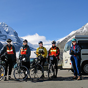 With the Athabasca Glacier behind us, on a gloriously sunny day we depart Columbia Icefield Visitor Center in Jasper National Park, heading for Sunwapta Pass (6676 feet elevation), along a 187-mile bicycle ride from Jasper to Banff in Alberta, CANADA. This is part of the Canadian Rocky Mountain Parks World Heritage Site declared by UNESCO in 1984. Published in Sierra Magazine, Sierra Club Outings May/June 2006. For licensing options, please inquire.