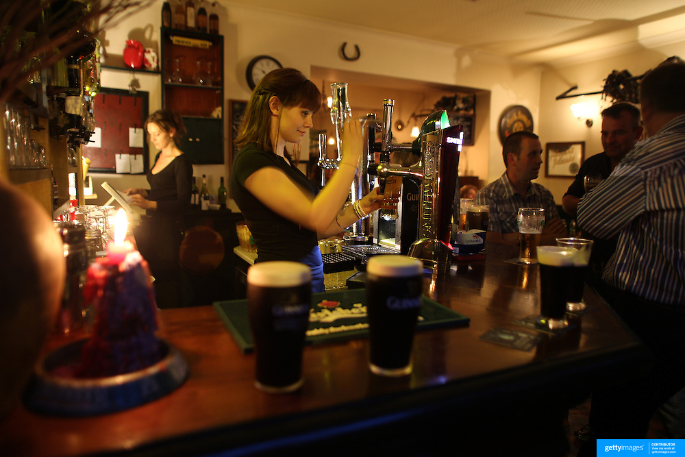 A bar scene showing pints of Guinness on a bar in Kenmare, Country Kerry, Ireland. Photo Tim Clayton
