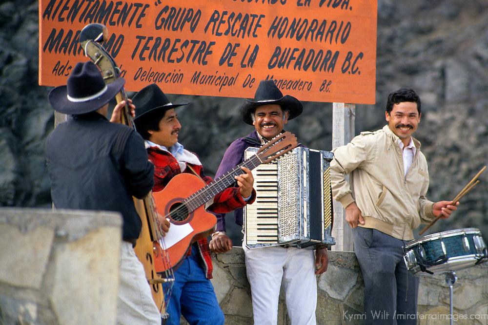 North America, Mexico, Baja California, Ensenada. A group of happy musicians play music for tourists and visitors to La Bufadora.
