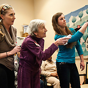 Occupational Therapy students shows clients how to play a Wii bowling game at The Buddy Coholan Center in Medford. (Alonso Nichols/Tufts University)