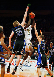Nov 21, 2008; New York, NY, USA; Duke Blue Devils forward Kyle Singler (12) tries to block a shot by Michigan Wolverines guard Manny Harris (3) during the 2K Sports Classic Championship game at Madison Square Garden. Duke won 71-56.