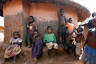 October 6, 2006 - Children hang out near a home at Coope camp for internally displaced people, or IDP, near Gulu in north Uganda. Coope, with a population of 18,000, is one of 76 IDP camps around Gulu, the main base for the Uganda Peoples Defense Force fighting the insurgent Joseph Kony's Lord's Resistance Army. Kony's LRA movement has been fighting for the past 20 years to force the East African country to be ruled according to the Christian Ten Commandments. Over 2 million people, mostly of the Acholi tribe, have moved or were forced to move from their villages to camps close to the towns of Gulu, Lira, and Kitgum where they are watched over by the Ugandan Army. The LRA rebels have abducted thousands of children and have forced them to fight against the Ugandan Army and the Acholi people. Current peace talks between Kony's LRA and the Ugandan government held in Juba, southern Sudan, offer a glimpse of hope to ending this ongoing conflict..(Photo by Jakub Mosur/Polaris)<br />