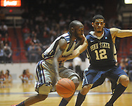 """Ole Miss guard Chris Warren (12) dribbles against Penn State guard Talor Battle (12) at the C.M. """"Tad"""" Smith Coliseum on Friday, November 26, 2010. Ole Miss won 84-71."""