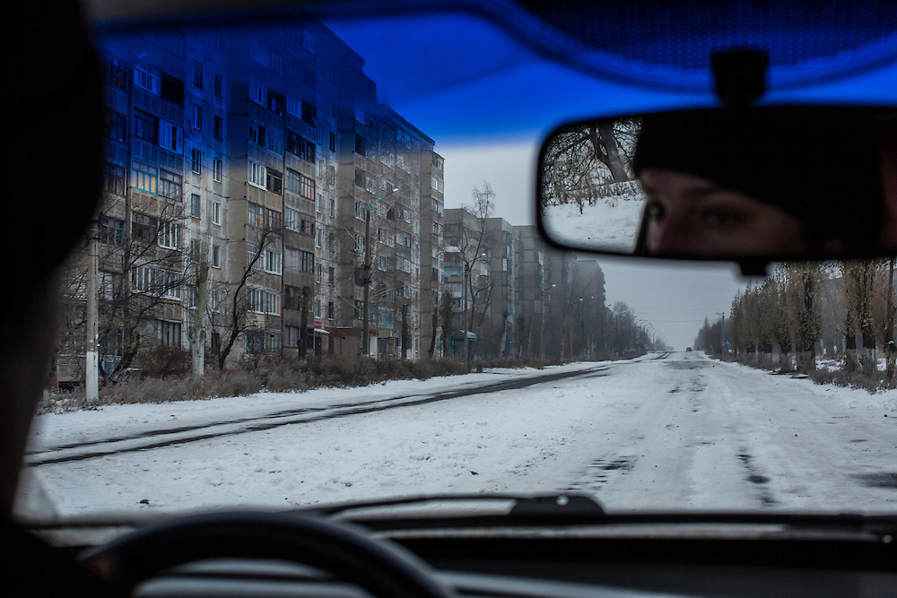 PERVOMAISK, UKRAINE - DECEMBER 8, 2014: A road lined with apartment buildings near where Petr Khokhlov, a member of the First Cossack Regiment Named Platov of the Great Don Army, is stationed in Pervomaisk, Ukraine. CREDIT: Brendan Hoffman for The New York Times