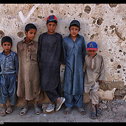 A group of young Afghan men gather on the streets near their destroyed homes in the Shomali Valley of Afghanistan Aug 29, 2002.