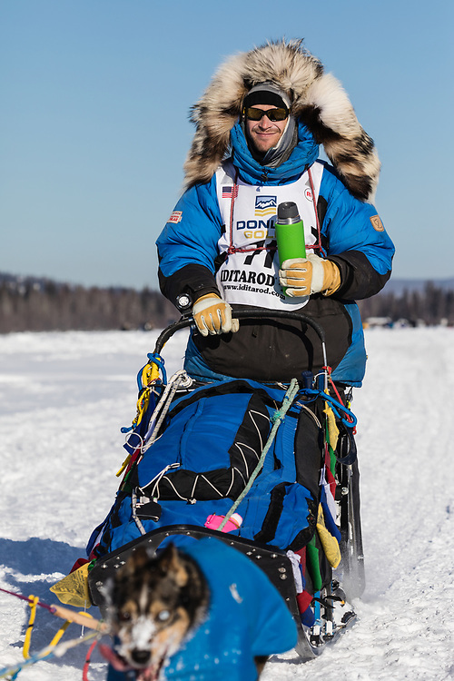 Musher Larry Daugherty competing in the 45rd Iditarod Trail Sled Dog Race on the Chena River after leaving the restart in Fairbanks in Interior Alaska.  Afternoon. Winter.