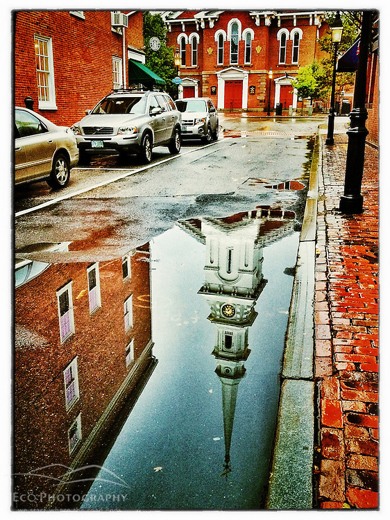 """The North Church reflected in a puddle in Portsmouth, New Hampshire. iPhone photo - suitable for print reproduction up to 8"""" x 12""""."""