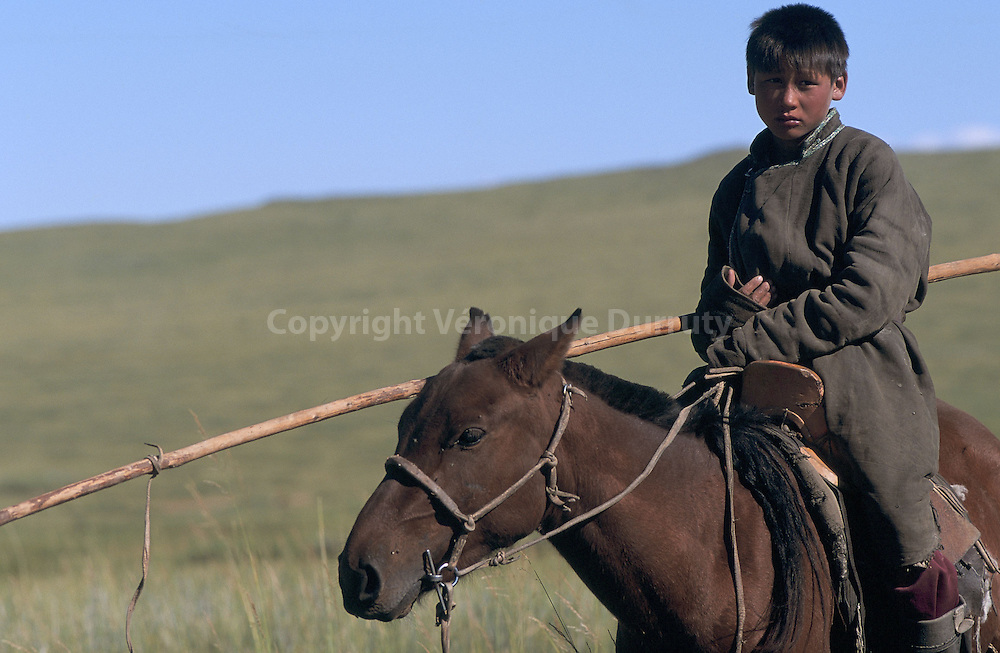 The urga is the traditional long pole with a noose, used by Mongolian horsemen to capture wild horses and runaway livestock.