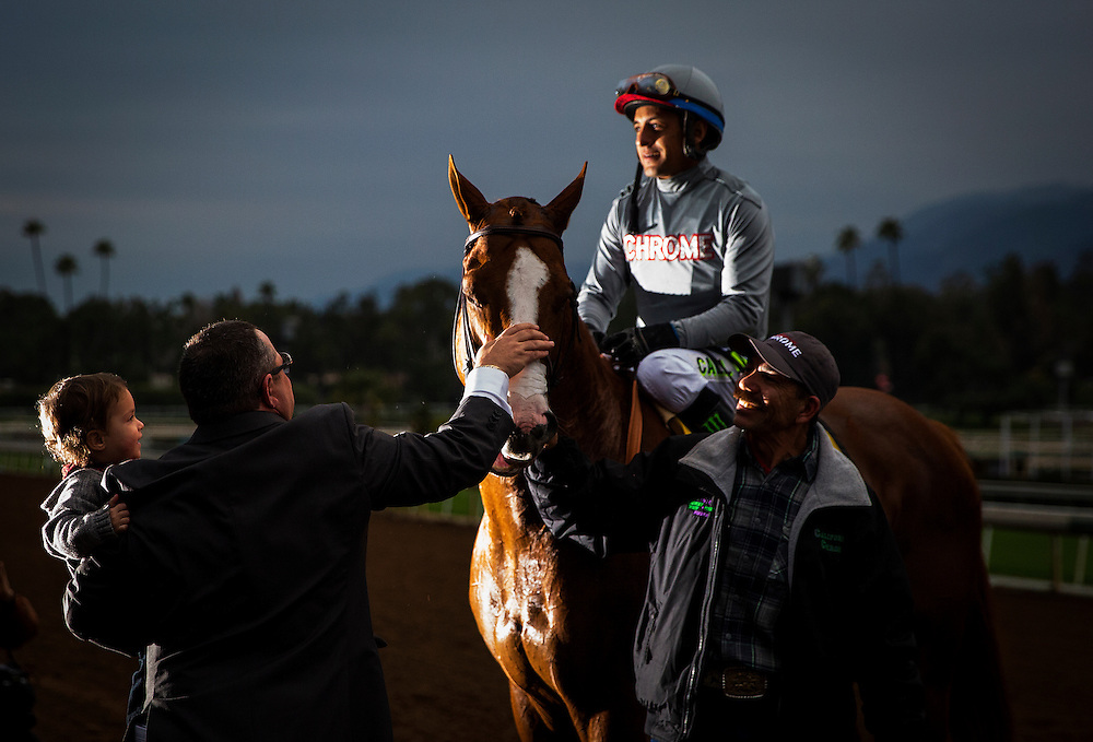 January 09, 2016: Alan Sherman with his grandson Logan celebrate after California Chrome and Victor Espinoza win the San Pasqual Stakes at Santa Anita Park, Arcadia CA. Evers/ESW/CSM