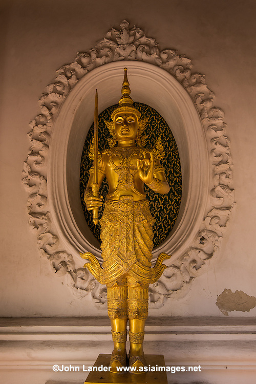 Guardian at Wat Phra Pathom - the temple claims to being Thailand's oldest Buddhist temple, dating back to the 6th century, although the present structure is mostly the handiwork of King Mongkut and his successors. The stupa is said to house a relic of the Buddha, but you can circumambulate the chedi in the inner courtyard. The temple is officially called Phra Pathommachedi and is located in the town of Nakhon Pathom. The name Phra Pathommachedi means Holy Chedi of the Beginning.