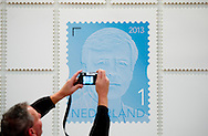 27-11-2013 THE HAGUE – King Willem Alexander of the Netherlands Receives his first King Willem Alexander Stamp at the communication museum in The Hague. COPYRIGHT ROBIN UTRECHT