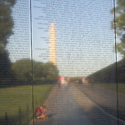 Washington Monument as reflected in the Vietnam Veterans Memorial Wall in Washington, DC. Reflection in every sense!