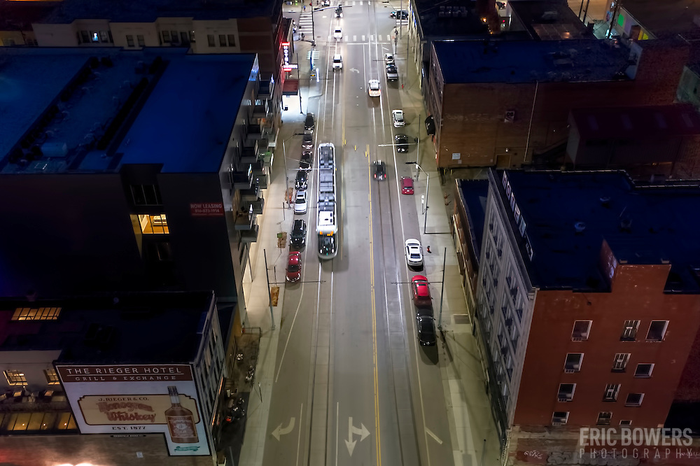 Kansas City, Missouri; downtown/Crossroads District at 20th & Main; view from above with KC Streetcar moving southbound in the evening.