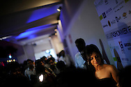 Bollywood actress Neetu Chandry talks to reporters during the New Delhi Fashion Week in New Delhi, India March 22, 2009. Photo by Keith Bedford