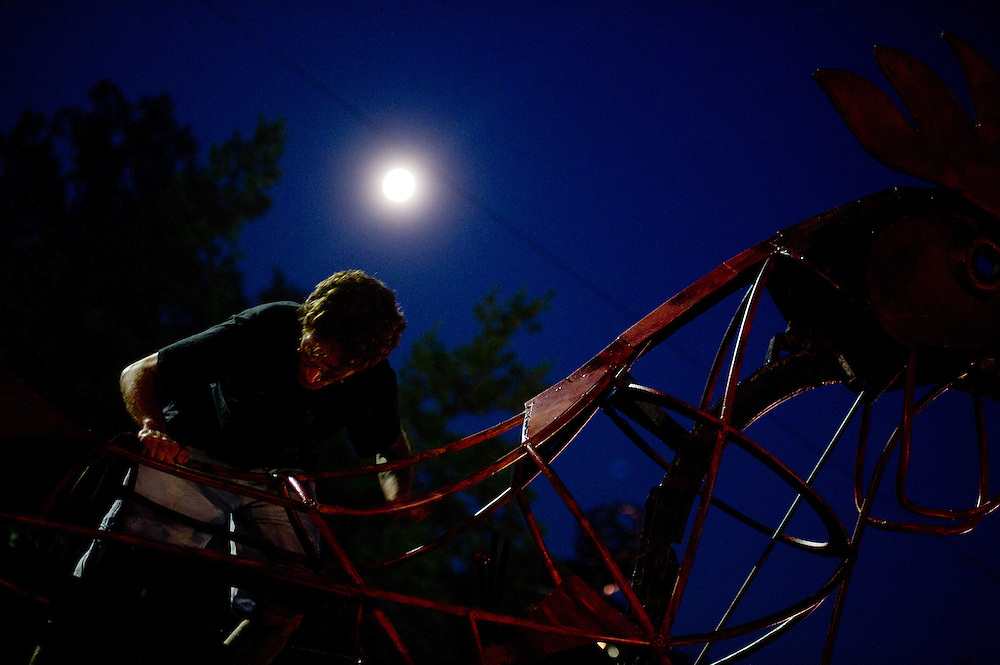 Sometimes you just need to climb a giant, metal chicken in the moonlight.